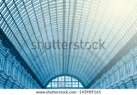 glass roof construction - old-fashioned style. blue color tone. - stock photo