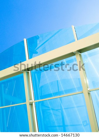 Glass roof on blue sky with white metal bars - stock photo