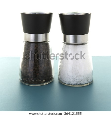 Glass salt and pepper grinders - stock photo