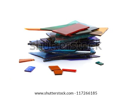 glass shards scattered across the white surface - stock photo