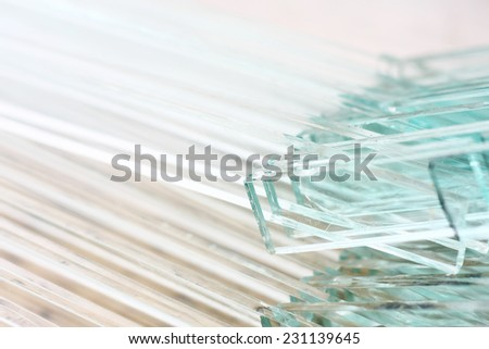 glass sheets placed next to each other - stock photo