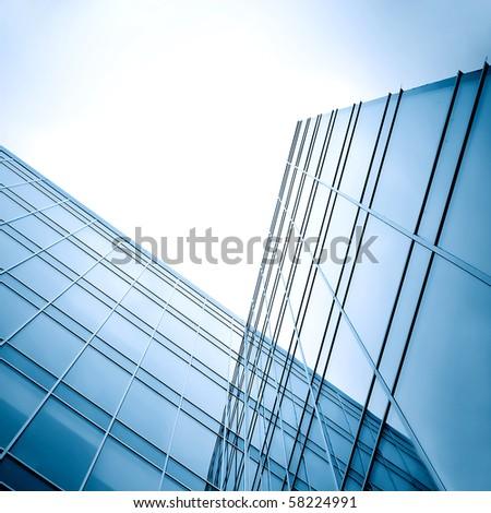 glass skyscraper at night - stock photo
