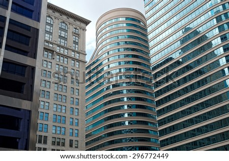glass skyscrapers and landmark building of vintage beaux arts architecture in downtown minneapolis minnesota - stock photo