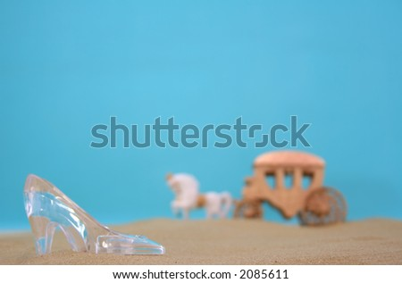 Glass Slipper on Beach With Carriage in Background - stock photo
