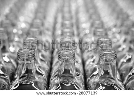 Glass square transparent bottles, factory lines and rows - stock photo