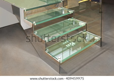 Glass Stairs With Metal Structure in Contemporary Home - stock photo