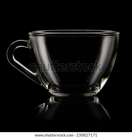 Glass tea cup on black background - stock photo