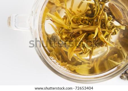 Glass teapot with hot white tea - stock photo
