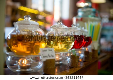 Glass teapots with color tea - stock photo