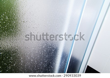 Glass texture background on shower room in bathroom with water drops