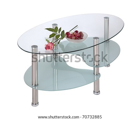 Glass top coffee table with two under shelves - stock photo