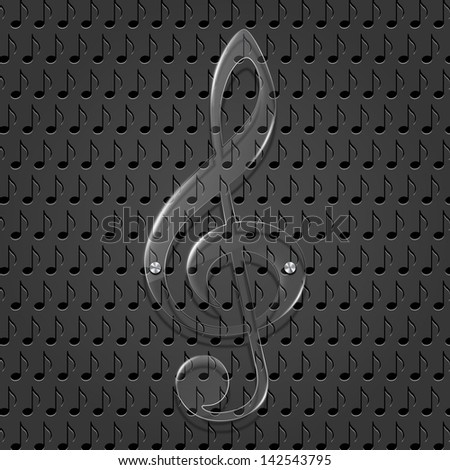 Glass treble clef on metal texture background. - stock photo