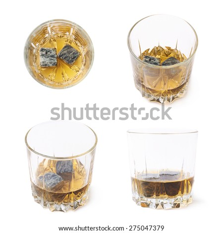 Glass tumbler filled with bourbon whiskey and granite cooling stones isolated over the white background, set of four different foreshortenings - stock photo