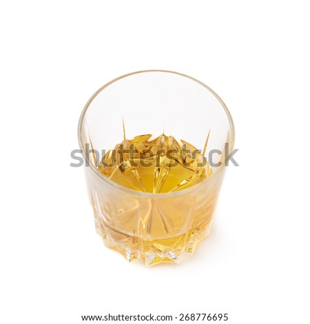 Glass tumbler filled with whiskey bourbon isolated over the white background - stock photo