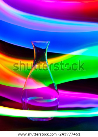 Glass vase with sparks and waves of light, lightpainting - stock photo