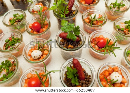 Glass vessels of a cold buffet with mixed food
