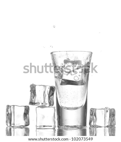 glass vodka and ice isolated on white - stock photo