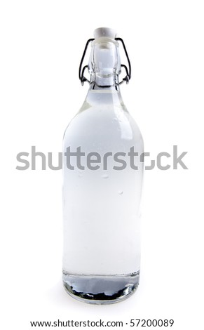 Glass water bottle on white background - stock photo