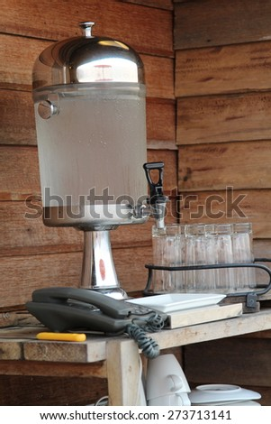 Glass water cooler contain cold water and ice inside. - stock photo