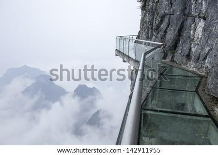 glass way on the cloud tianmen mountain hunan china - stock photo