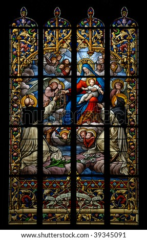 Glass window in French Church with Mary and Christ