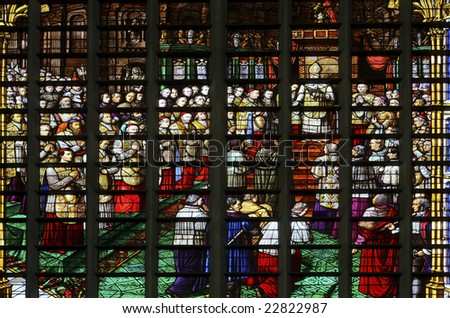 Glass window in the Saint Rumboldts cathedral of Mechelen, Belgium. The window depicts the reading of the dogma of the immaculate conception of Maria by the pope and was fabricated in Mechelen in 1860 - stock photo