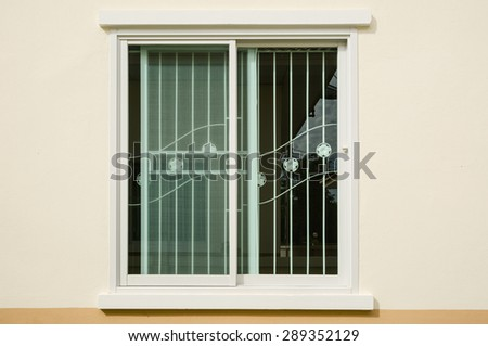 Glass window with curved steel  - stock photo