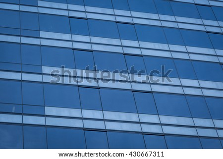 Glass windows of modern office building background