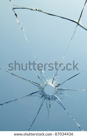 Glass  windows  shot  hole  cracks - stock photo