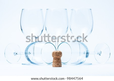 glass wine stand and lie symmetrically with cork - stock photo