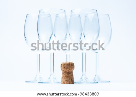 glass wine stand symmetrically with cork - stock photo