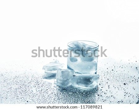 Glass with a drink and ice on a white background - stock photo