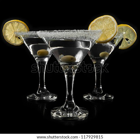 glass with a martini on a black background - stock photo
