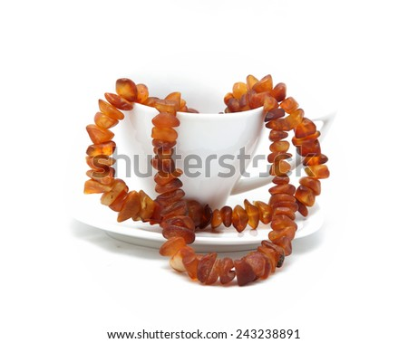 glass with amber necklace - stock photo