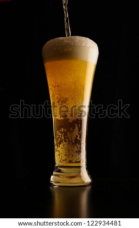 Glass with beer served on the table