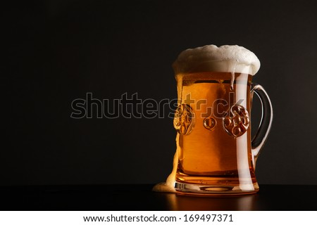 Glass with beer served on the table. - stock photo