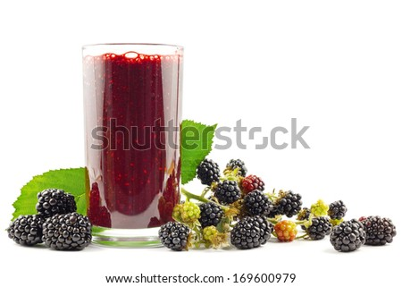 Glass with blackberry smoothie and blackberries on white - stock photo