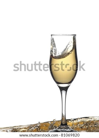 Glass with champagne in drops