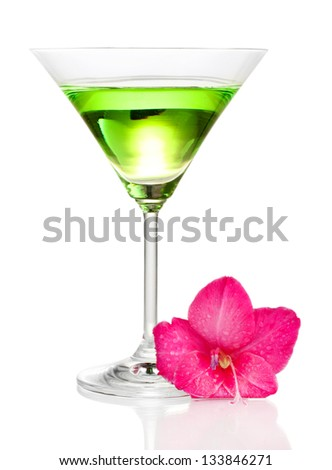 glass with cocktail and gladiolus bud isolated on white - stock photo