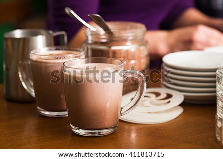 Glass with cocoa with milk on the table in cafe