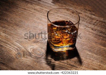 glass with cognac on the wooden table - stock photo