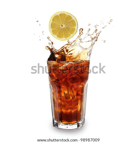 Glass with cola and falling lemon - stock photo