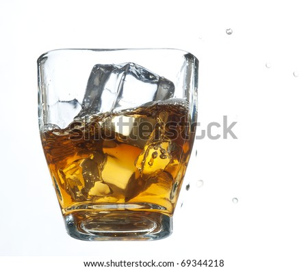 Glass with cold whiskey on the white background