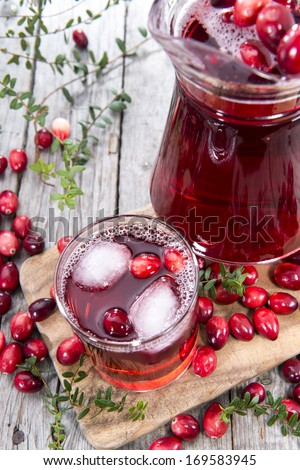 Glass with Cranberry Juice and Ice Cubes - stock photo