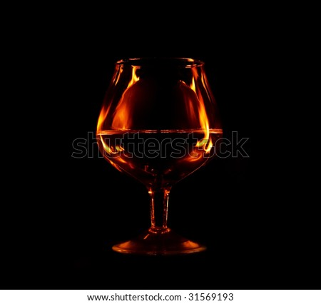 glass with fire flames reflection in it - stock photo