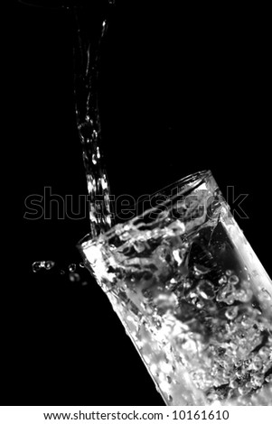 glass with fresh cold water splashing outside