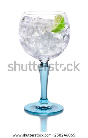 Glass with gin, tonic, lime and ice - stock photo