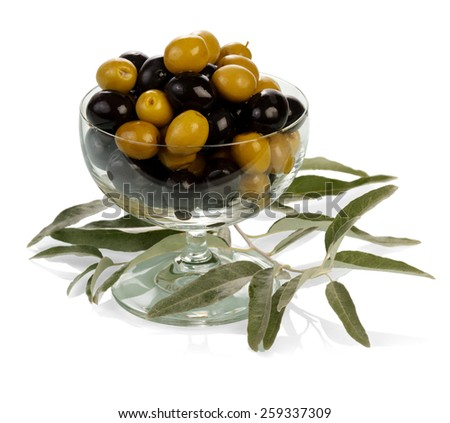 Glass with green and black olives - stock photo