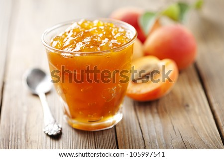 glass with homemade apricot jam