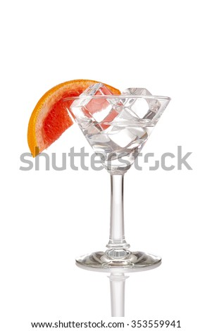 Glass with ice cubes and orange. Isolated on white - stock photo